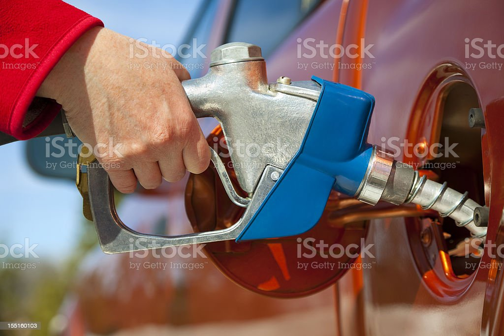 Pumping Gas Into Gas-Guzzler Vehicle stock photo