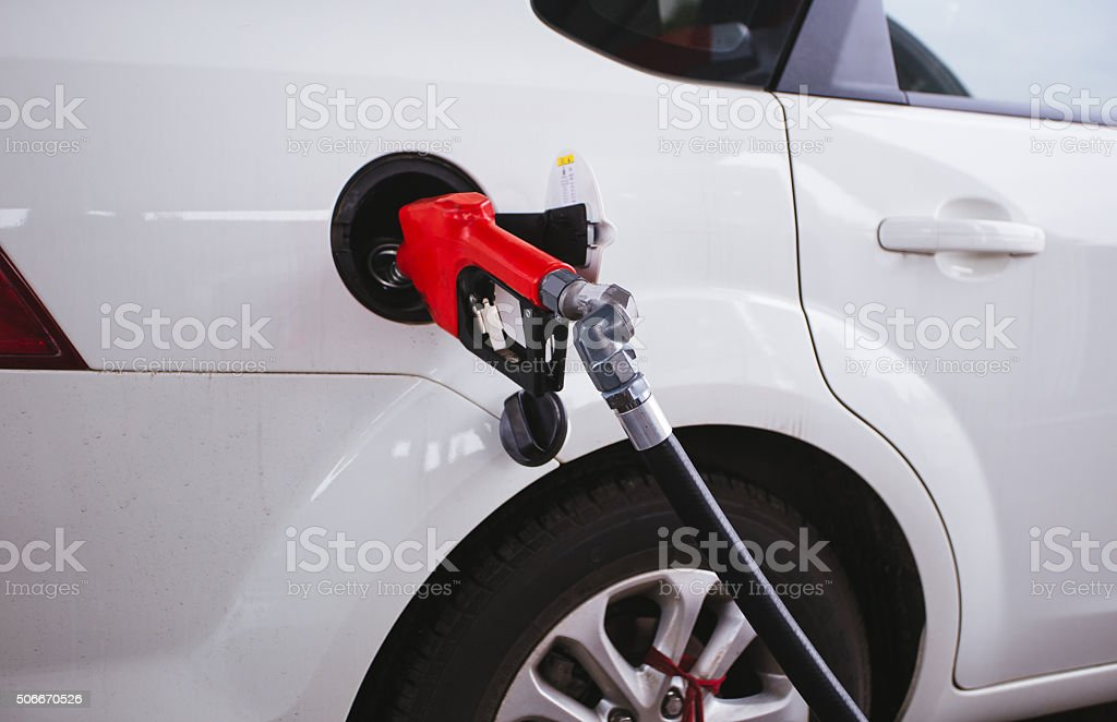 pumping gasoline fuel in car stock photo