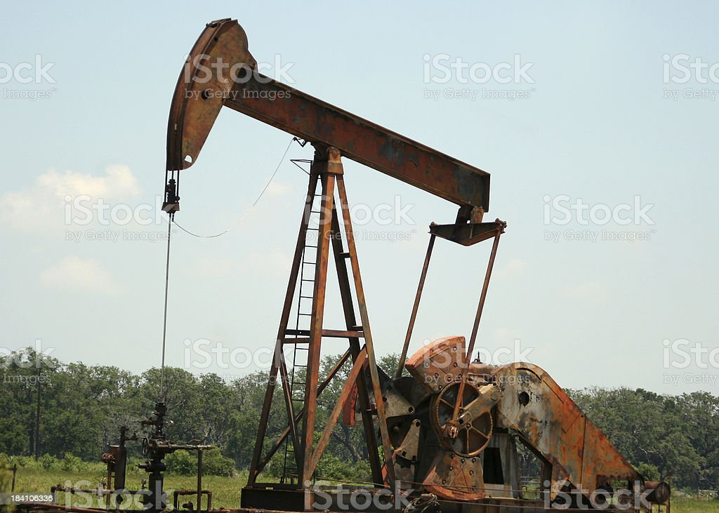 Pumping Oil - Old Pumpjack stock photo
