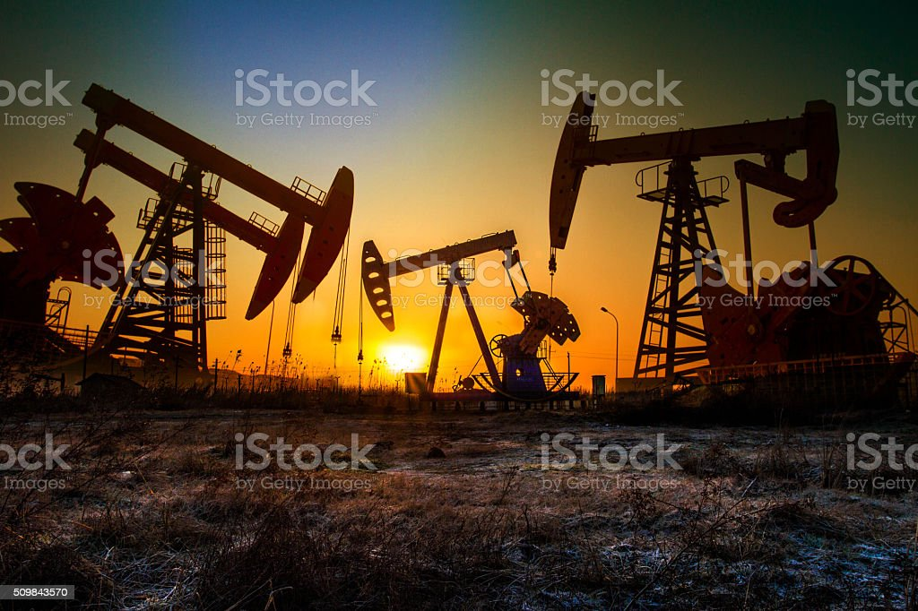 pumping unit in sun stock photo