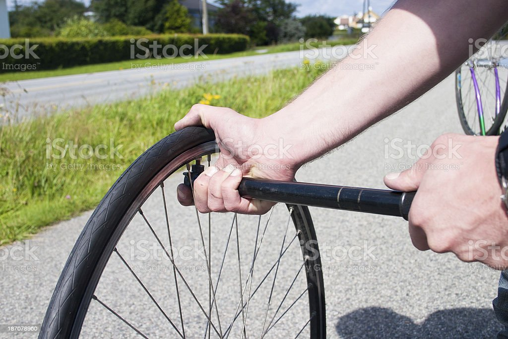 Pumping up a flat tire stock photo