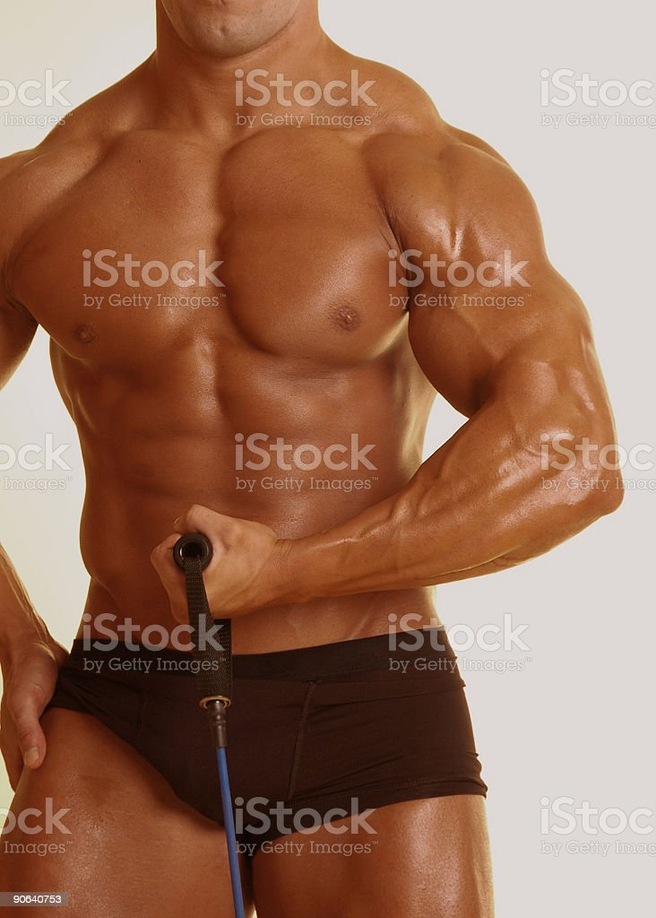 pumping with a resistance strap royalty-free stock photo