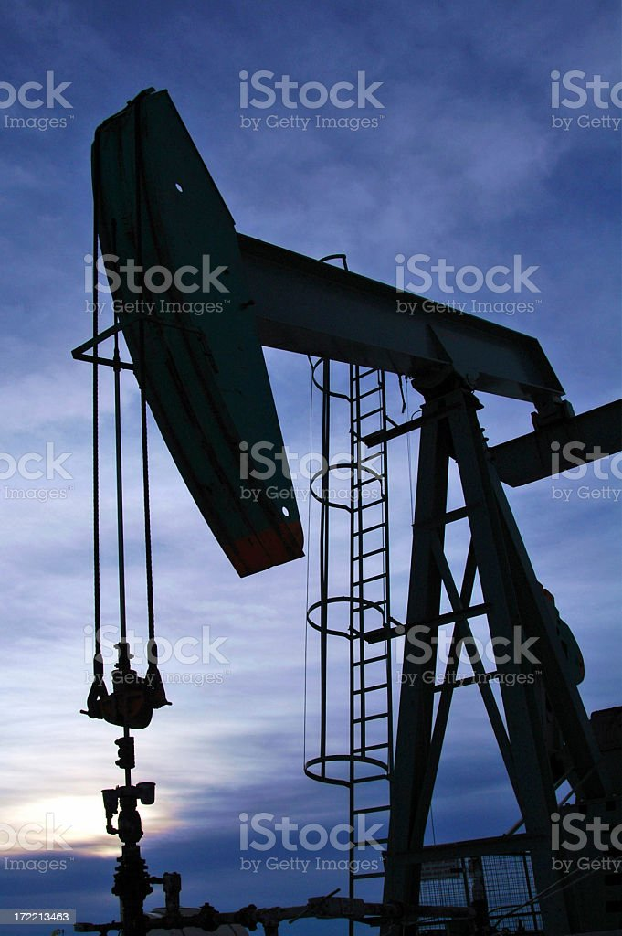 pumpjack against blue stock photo