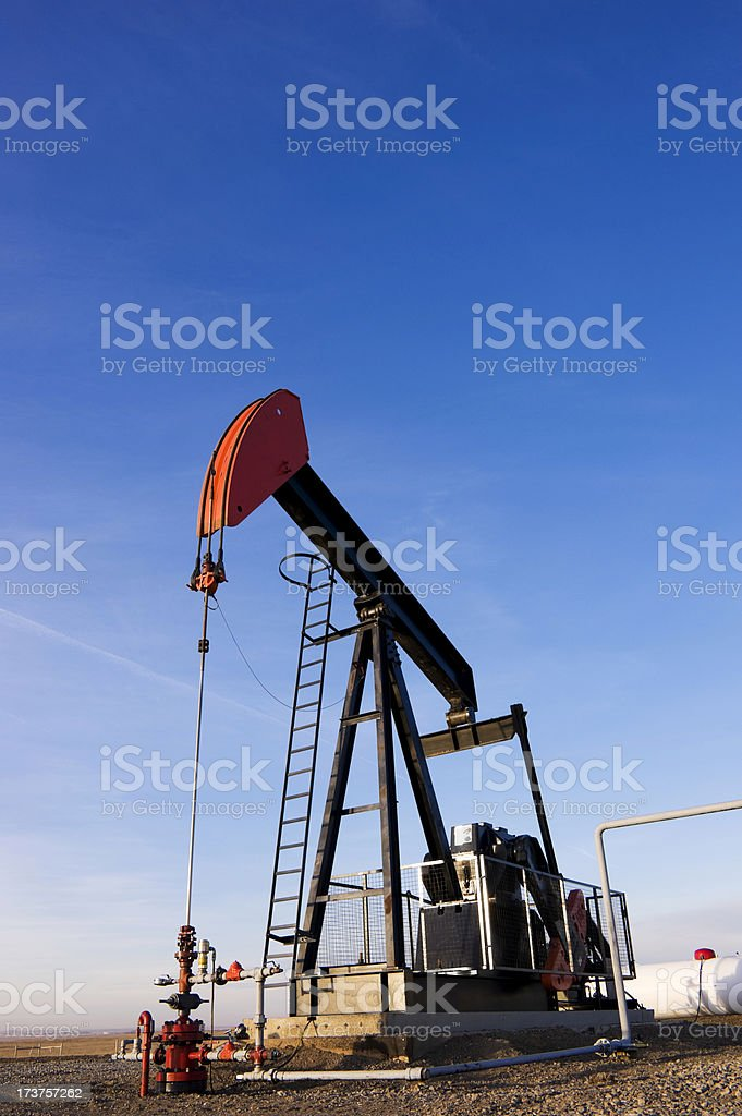 Pumpjack against blue sky royalty-free stock photo