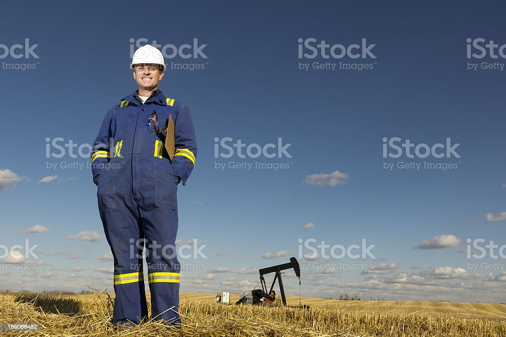 Pumpjack and Engineer royalty-free stock photo