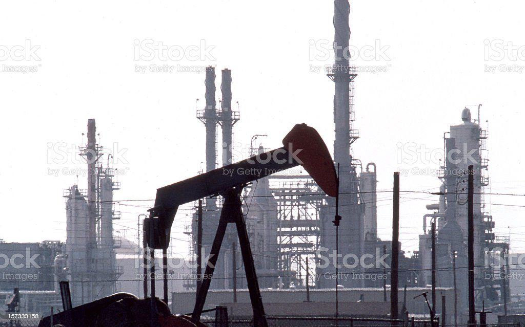 Pumpjack and Refinery royalty-free stock photo