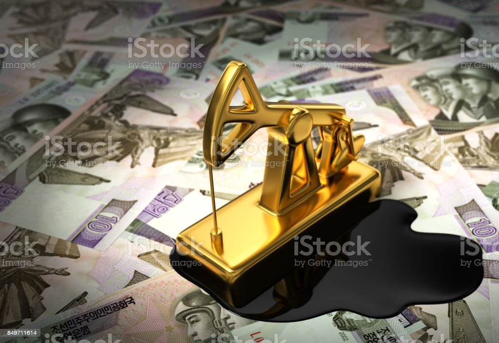 Pumpjack And Spilled Oil On North Korean Wons stock photo