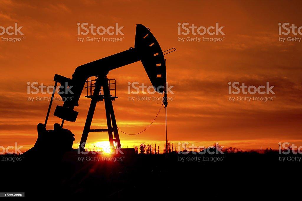 Pumpjack as the sunrises stock photo