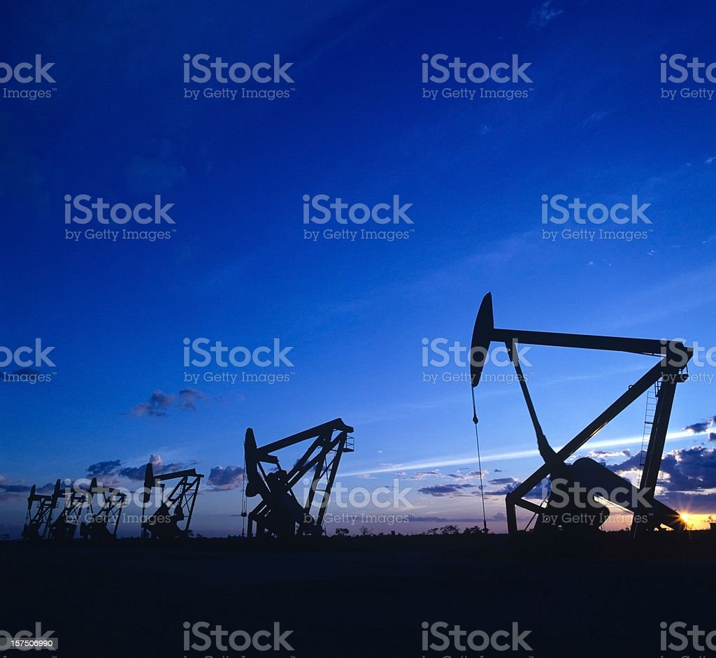 pumpjack at sunset royalty-free stock photo