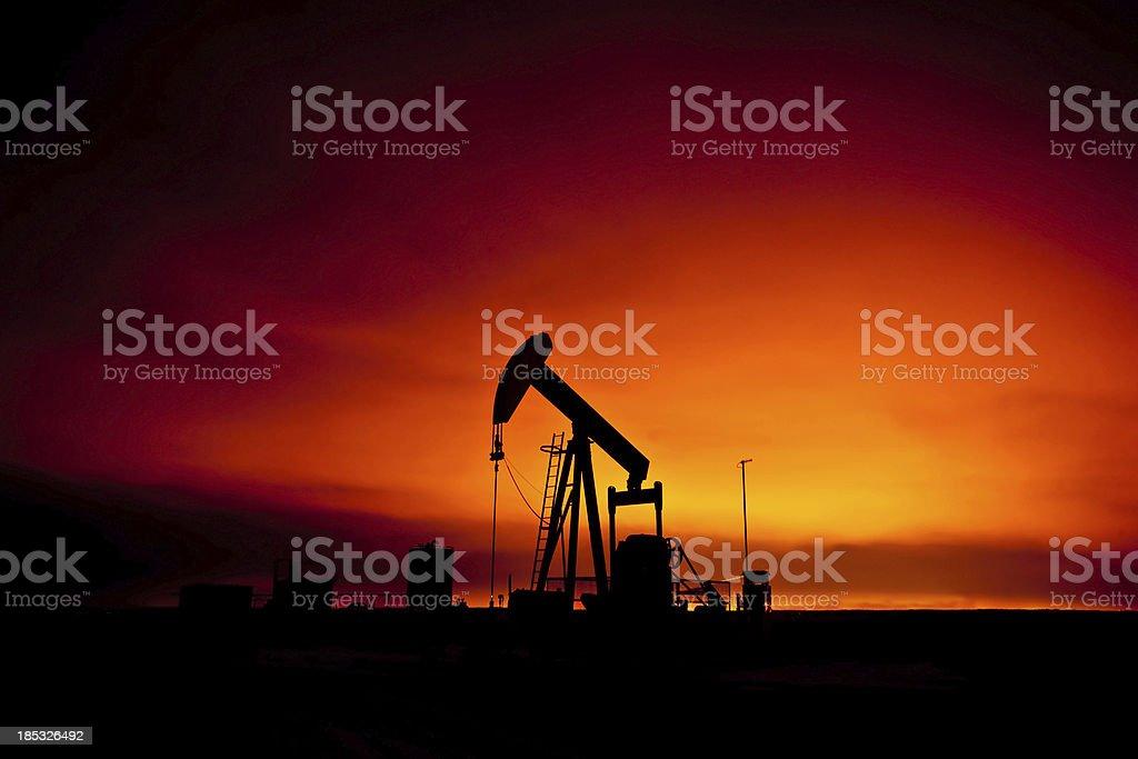 Pumpjack at sunset royalty-free stock photo