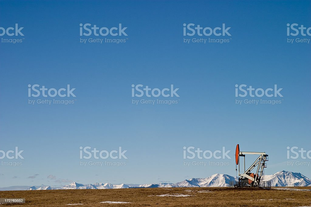pumpjack by the mountains stock photo