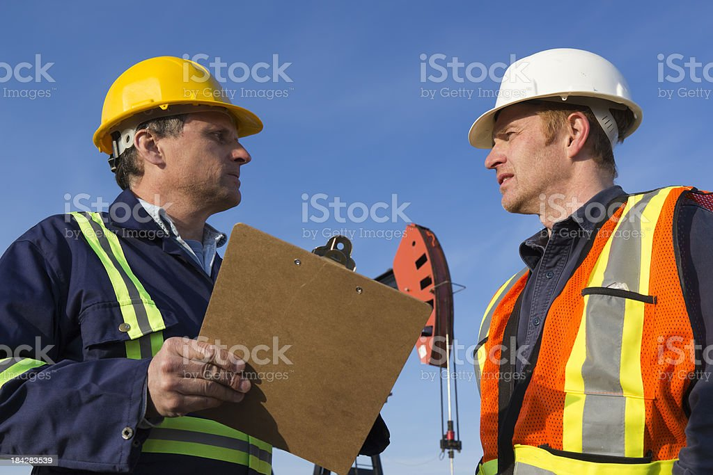 Pumpjack Discussion royalty-free stock photo