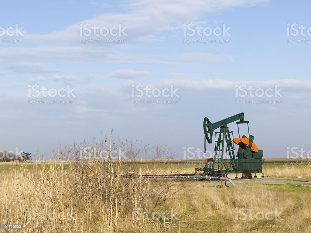 Pump-jack in the valley royalty-free stock photo