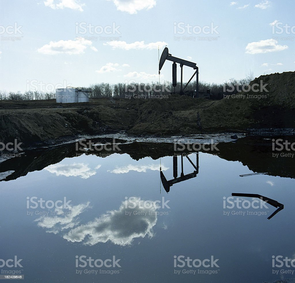 Pumpjack Reflected in a Pool stock photo