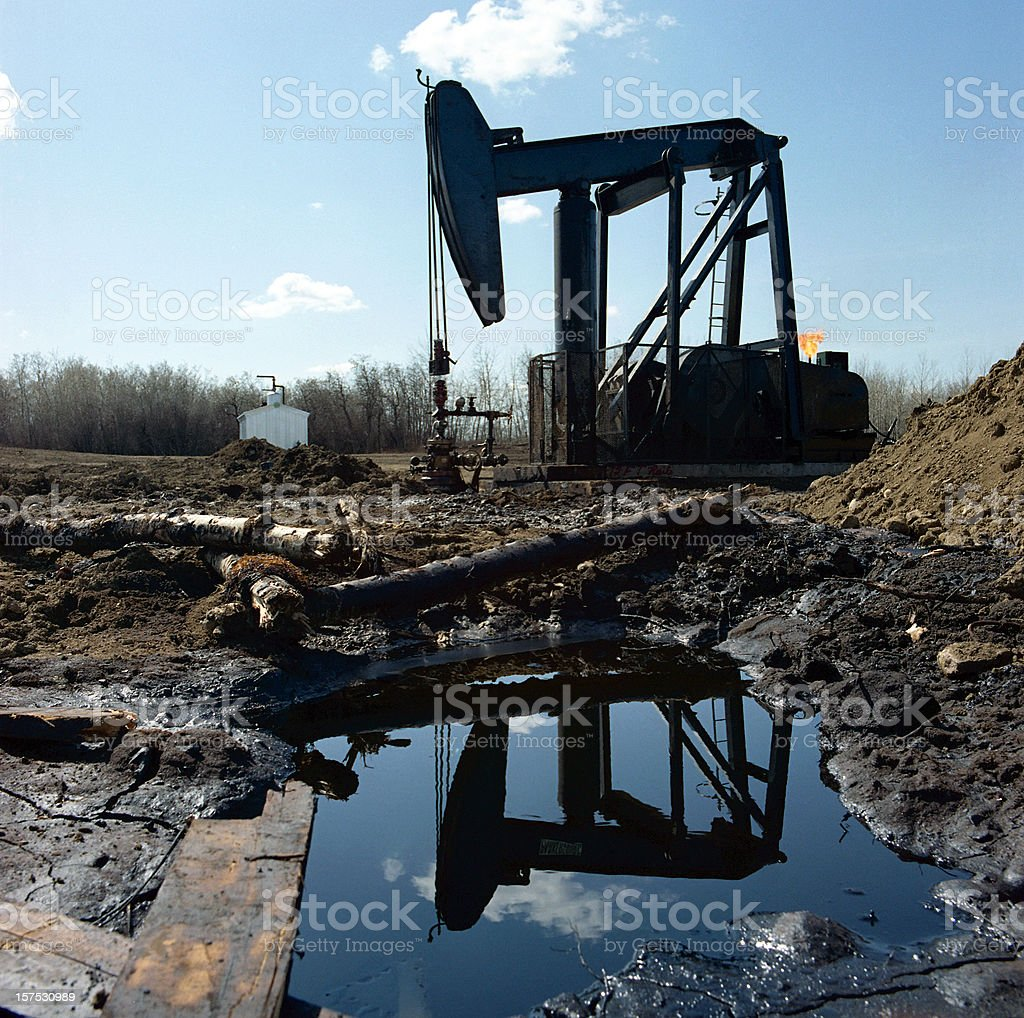 Pumpjack Reflected in Water stock photo