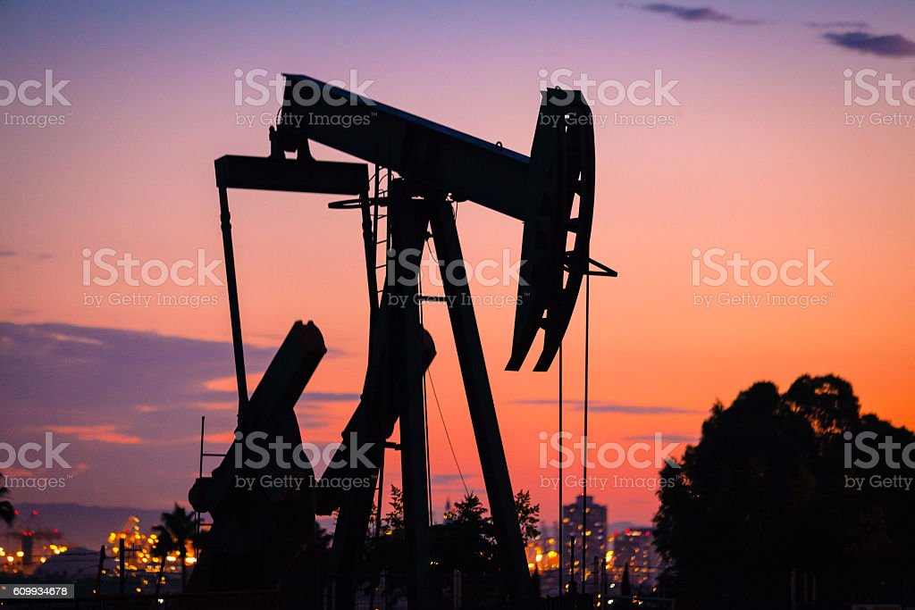 Pumpjack Silhouette At Sunset In Signal Hill,  Overlooking Long Beach royalty-free stock photo