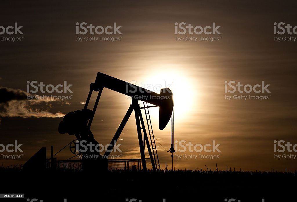 Pumpjack Silhouette on the Great Plains in Alberta stock photo