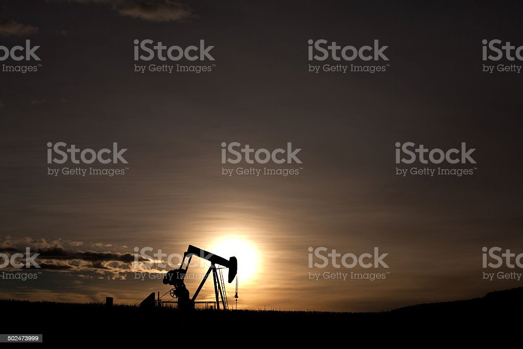 Pumpjack Silhouette on the Great Plains in Texas stock photo