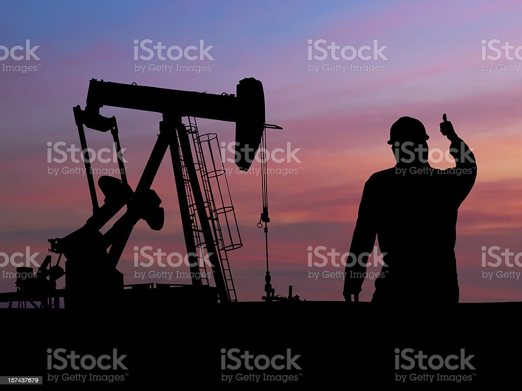 Pumpjack Silhouette with Oil Worker royalty-free stock photo