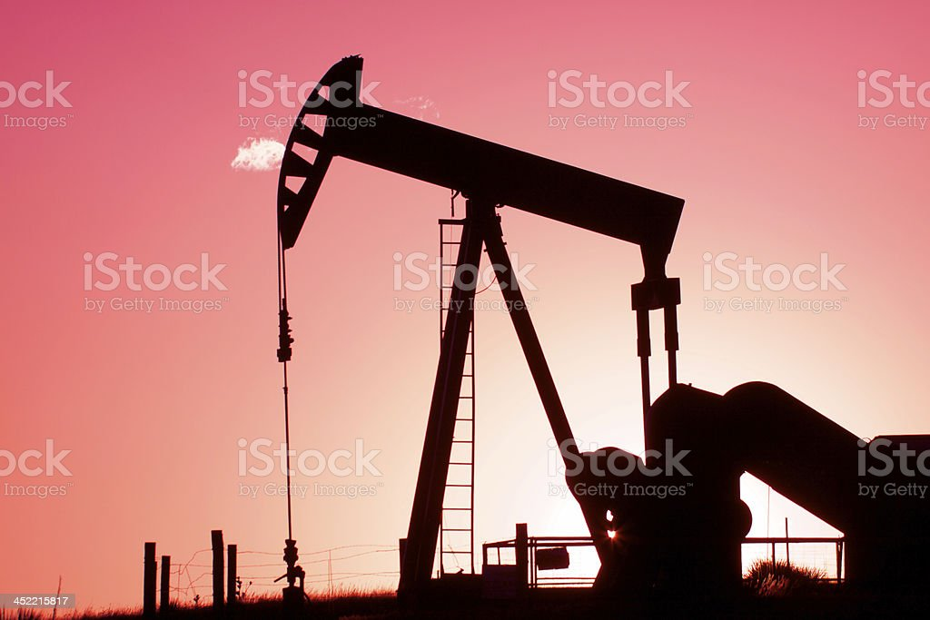 Pumpjack Silhouetted at Sunset royalty-free stock photo