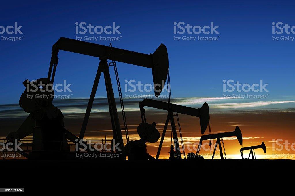XXXL pumpjack silhouettes stock photo