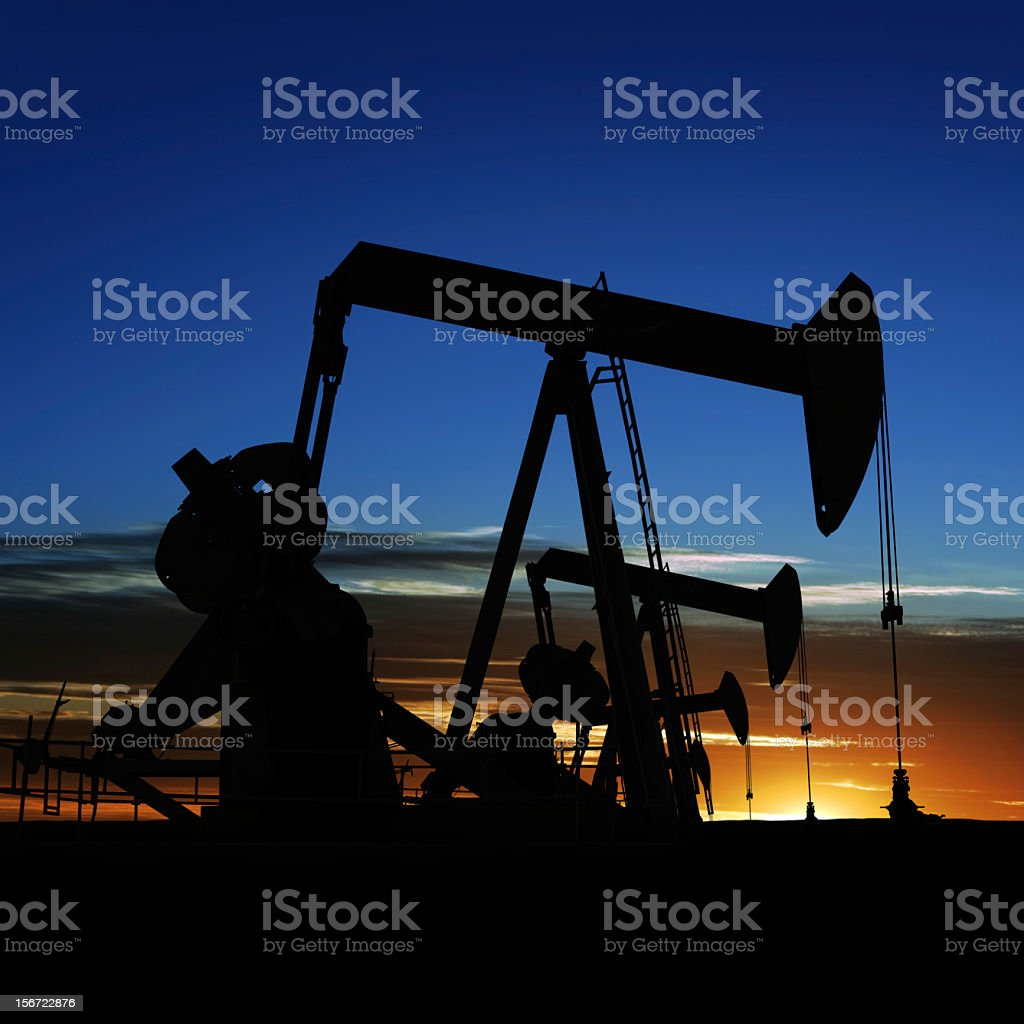 XXXL pumpjack silhouettes royalty-free stock photo
