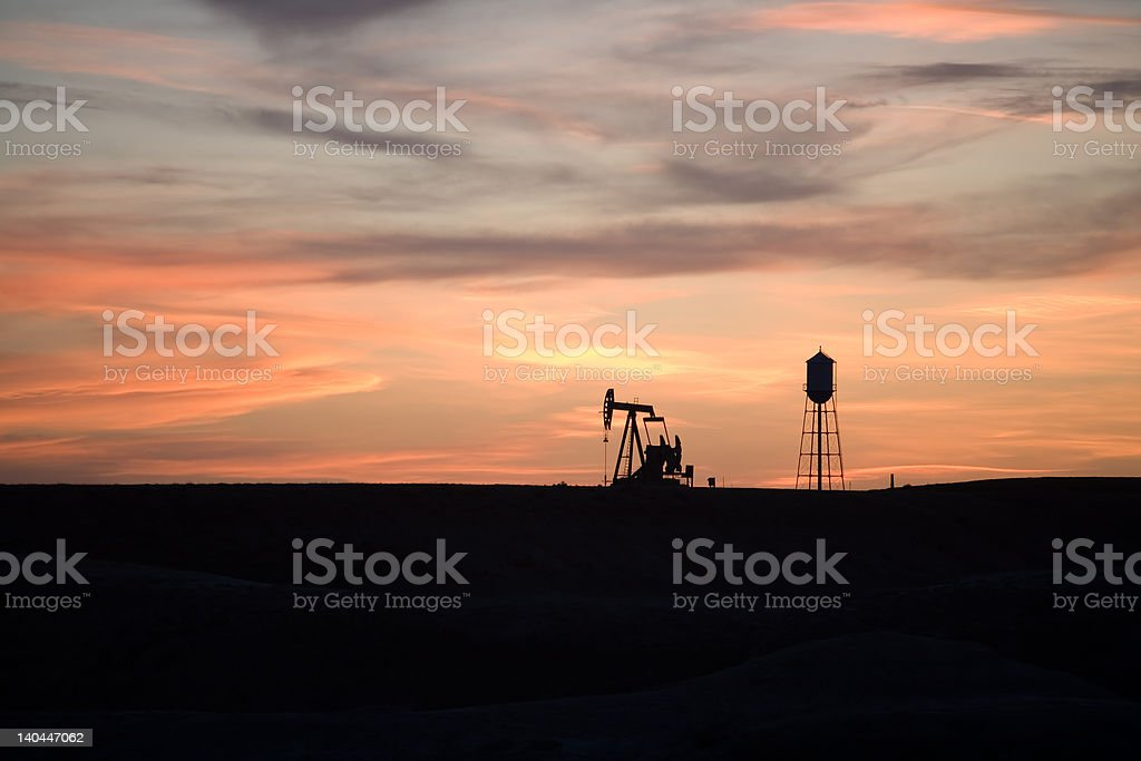 pumpjack sunset royalty-free stock photo