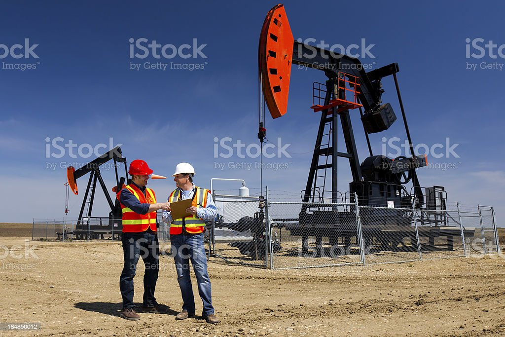 Pumpjacks and Workers royalty-free stock photo
