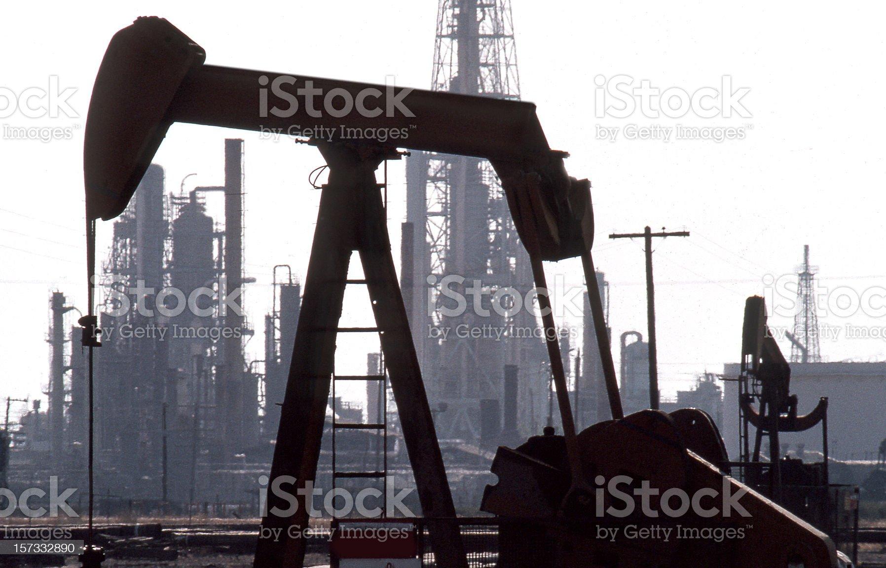 Pumpjacks in front of Old Refinery royalty-free stock photo