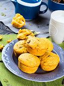 Pumpkin and apple muffins. Vertical