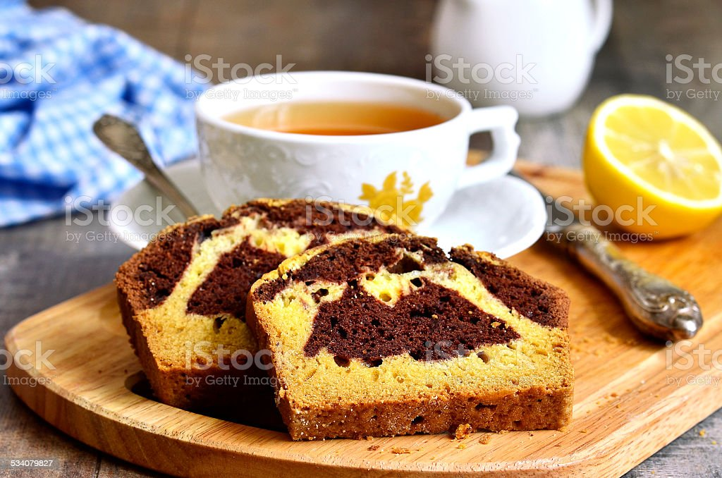 Pumpkin and chocolate cake with cup of tea. stock photo