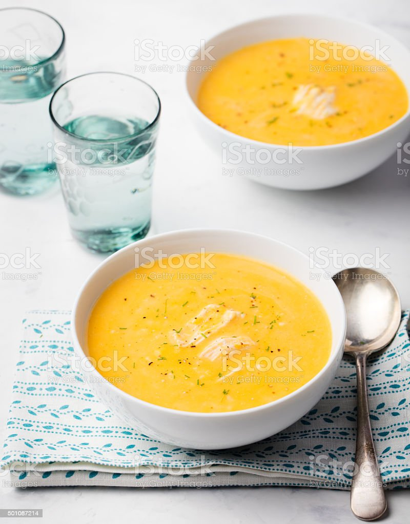 Pumpkin and coconut soup with chicken stock photo