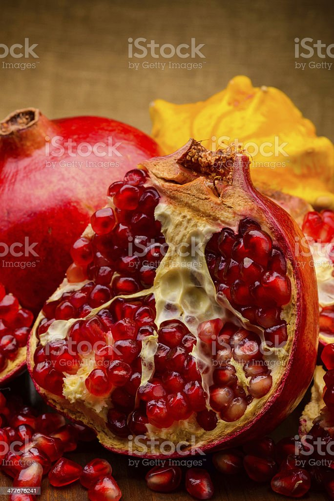 pumpkin and pomegranate on fabric background royalty-free stock photo