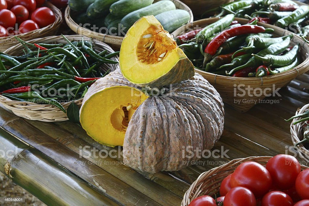 pumpkin and vegetables on table stock photo