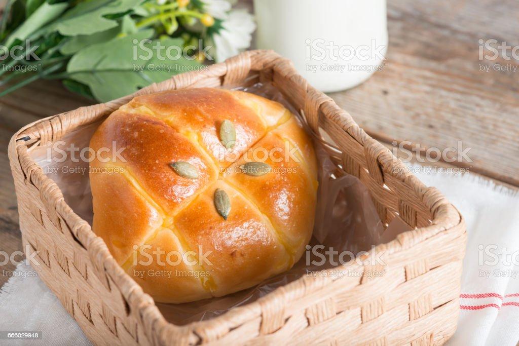 Pumpkin bun topping with pumpkin seeds in the basket. stock photo