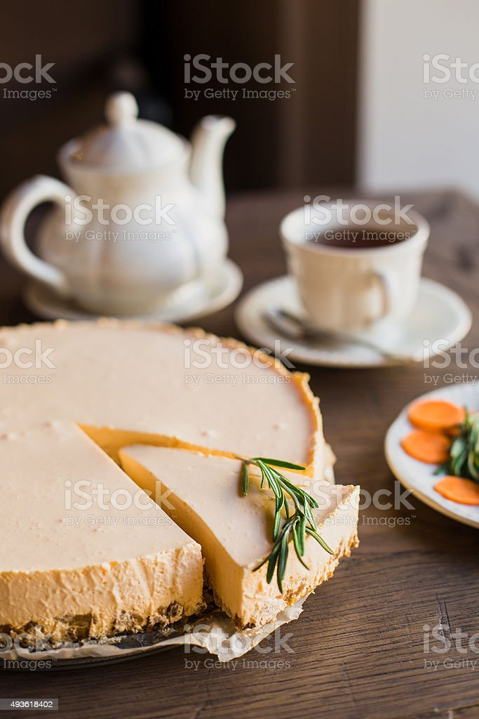 Pumpkin cheesecake and hot tea stock photo
