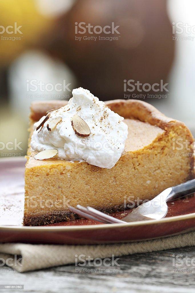 Pumpkin Cheesecake Pie with Whipped Cream stock photo