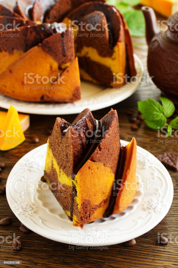Pumpkin chocolate cake with frosting. stock photo