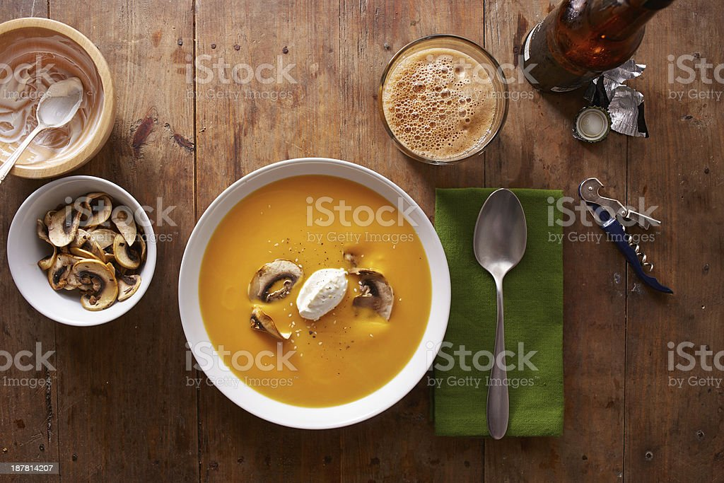 Pumpkin cream dinner on wooden table stock photo