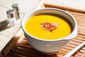 pumpkin cream soup with ham shavings