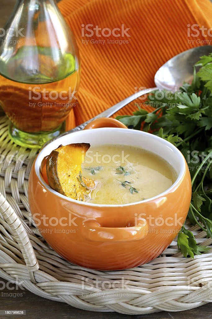 pumpkin cream soup with thyme royalty-free stock photo