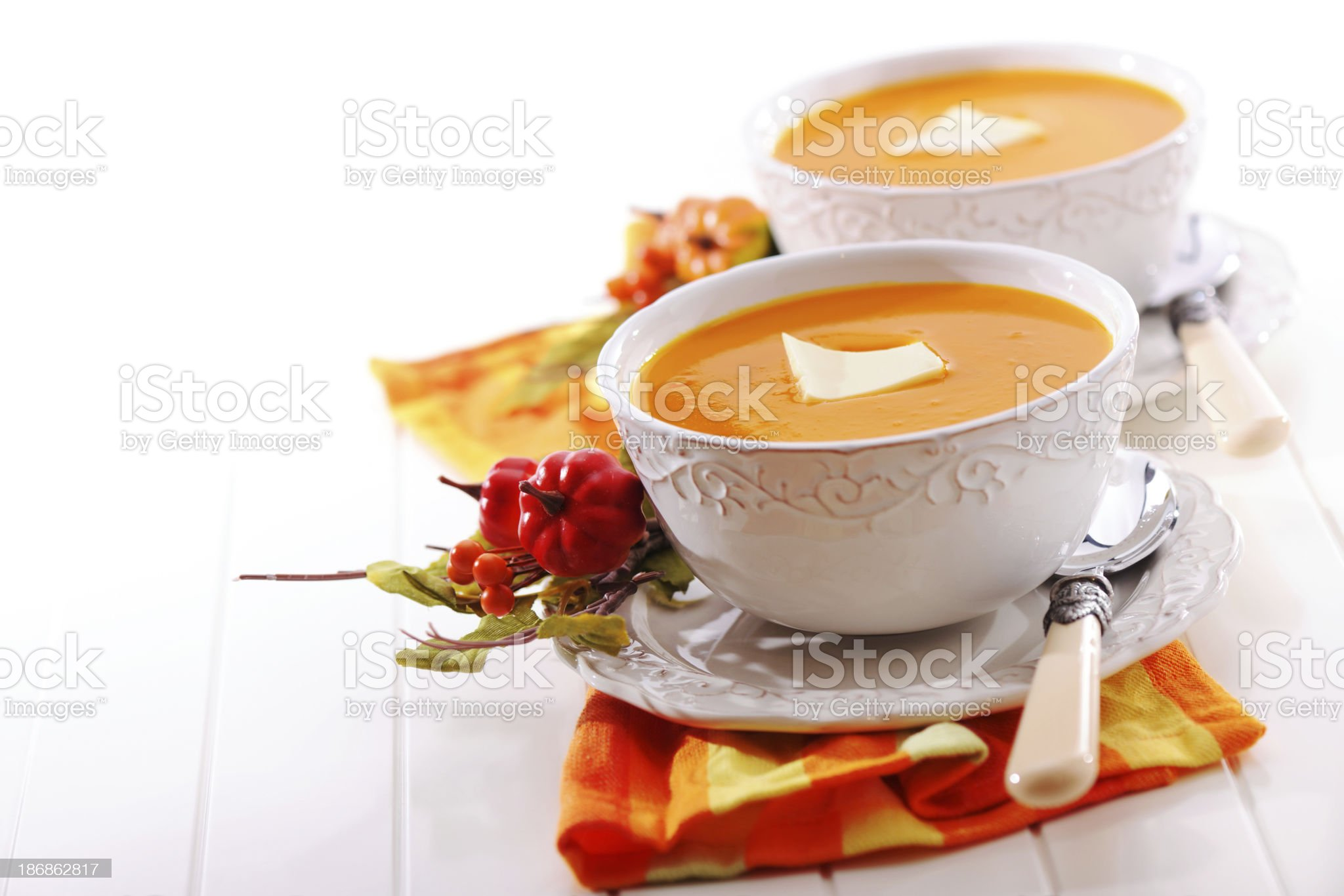 Pumpkin creme soup with melted butter royalty-free stock photo