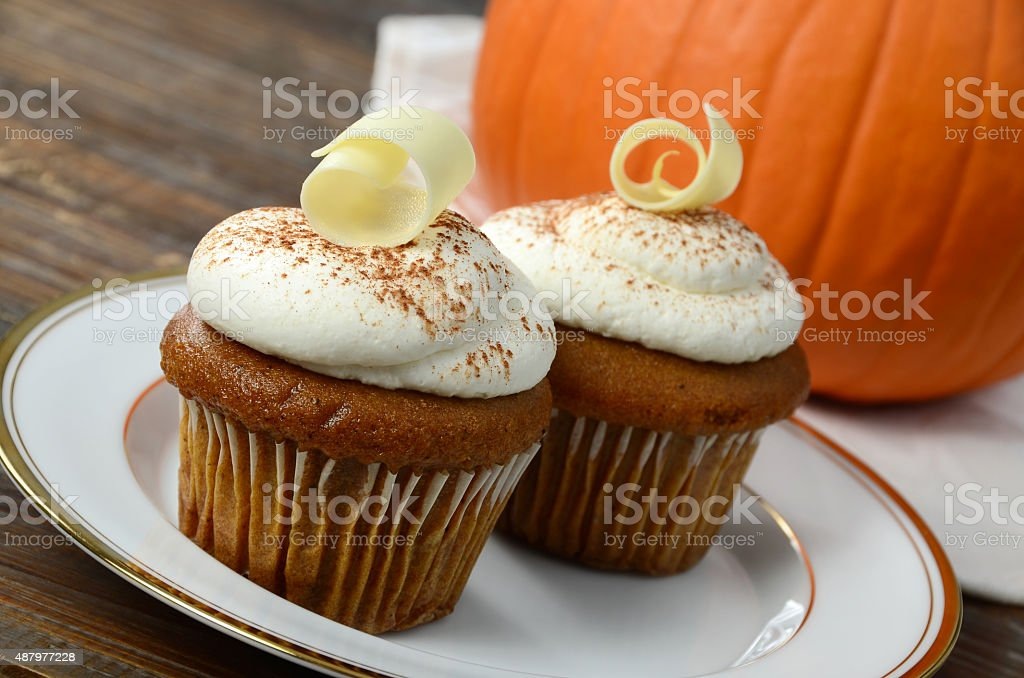 Pumpkin Cupcakes with Cream Cheese Frosting stock photo