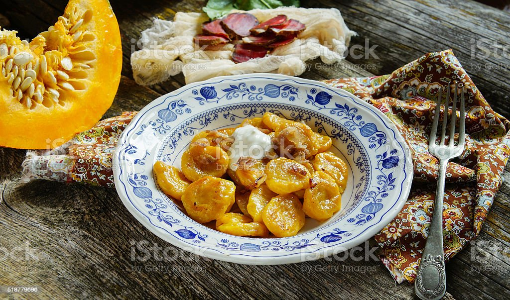 pumpkin gnocchi with greaves stock photo