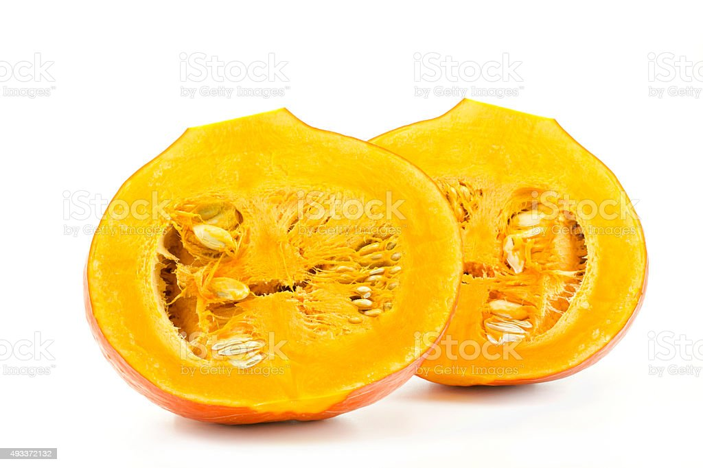 Pumpkin halves isolated on white background stock photo