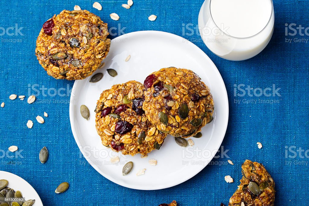 Pumpkin, oat cookies with cranberries, maple glaze, glass of milk stock photo