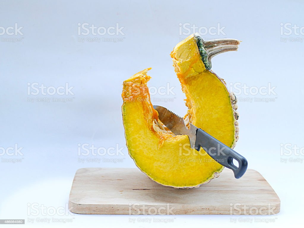 pumpkin on cutting board royalty-free stock photo