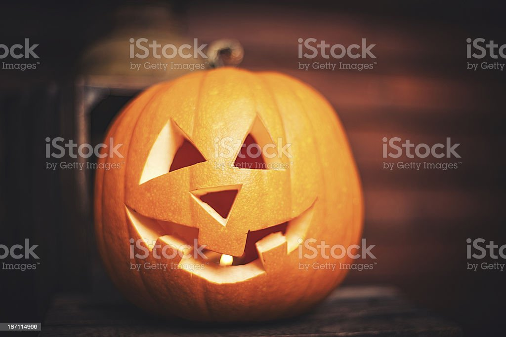 Pumpkin on front step with halloween decorations royalty-free stock photo