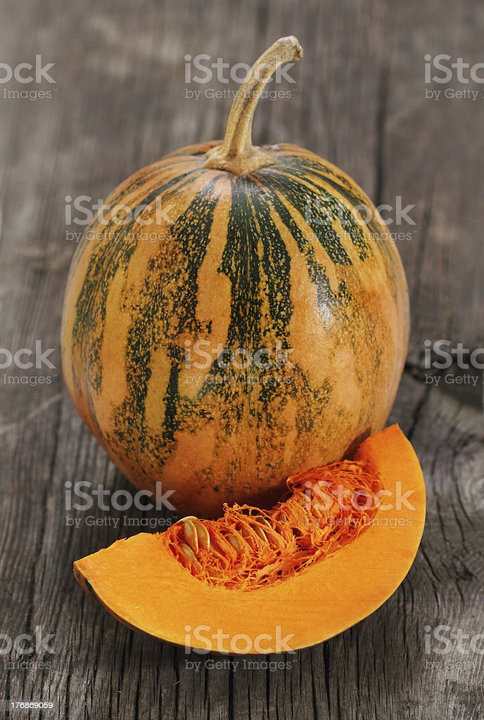 Pumpkin on the wooden background royalty-free stock photo