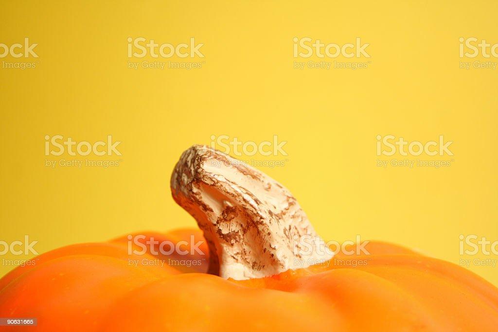 Pumpkin on yellow royalty-free stock photo